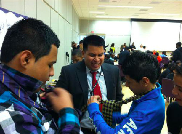 Learning how to tie a tie at the Color of Leadership Boys' Conference