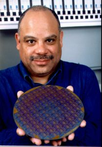 Dr. Mark E. Dean, director of IBM's Austin Research Laboratory in Austin, Texas, displays a wafer containing 1000 MHz microprocessors, in this undated photo. The laboratory announced the technological breakthrough Wednesday, Feb. 4, 1998, in San Francisco. (AP Photo/IBM)