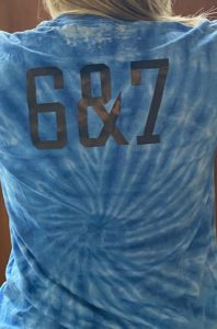 "The back of a tie-dye shirt with ""6&7"""